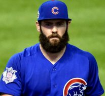 Jake Arrieta pays off a bet with a Cubs teammate with an embarrassing tattoo
