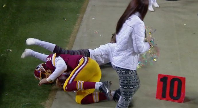 Redskins cheerleader gets leveled when Kirk Cousins is shoved out of bounds