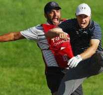 Spieth holes bunker shot to win playoff